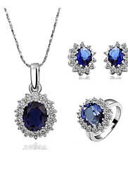 parure ciomplète de bijoux en cristaux blaus et zirconium