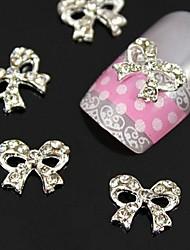 10pcs clair strass arc accessoires alliage de cravate d'ongles nail art décoration