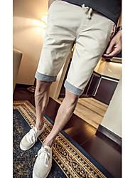 Masculino Solto Chinos / Shorts Calças-Cor Única Casual Simples Cintura Média Zíper Algodão Micro-Elástico Verão