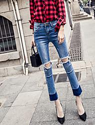 A nova primavera e verão joelho buraco estiramento jeans pés era cintura fina calcinha casual feminino micro-bell-bottoms