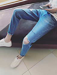 Teen hole Slim jeans male Korean version of the tight spring men's pantyhose feet long pants tide students